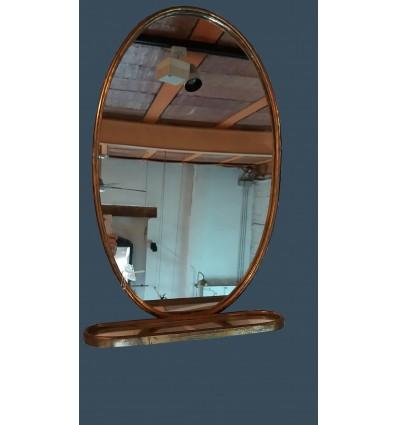 Espejo oval con repisa
