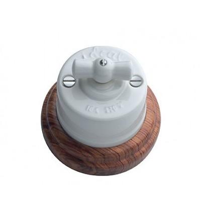 image: Conmutador superficie lazo porcelana y base madera